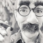 Man in Groucho Marks mask; courtesy of gratisography